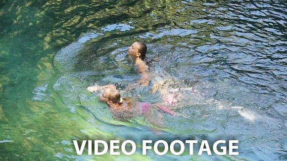 Girl swimming in the lake.