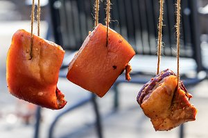 Three bacon hanging outside