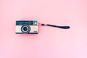 Vintage camera, pink bg, hero header