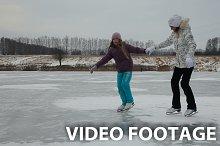 girls ice skating on frozen lake