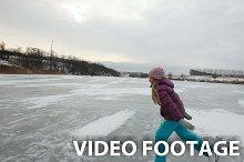 girl ice skating on frozen lake