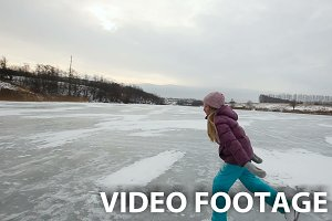 girl ice skating on frozen lake