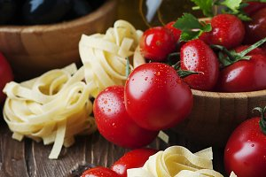 Uncooked pasta with tomato and olive
