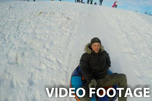 Man sledging down hill