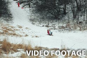 Yong girls sledging down hill