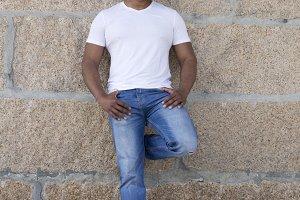 black man against wall