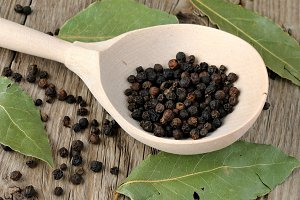 Black pepper in spoon close-up