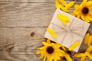 Decorative sunflowers and gift box