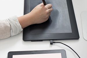 Woman hands using a graphics tablet