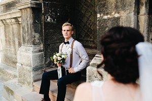 bride sitting on stone steps