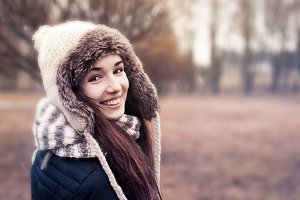 girl in a winter hat smiling