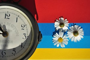 station clock and daisies