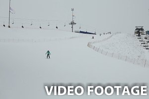 woman skier down the hill