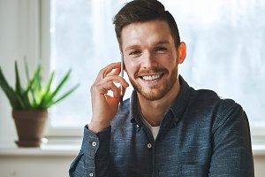 Smiling man talking on phone