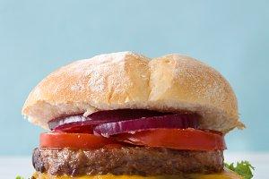 Homemade burger. Blue background