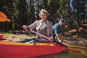 Happy senior woman in a kayak