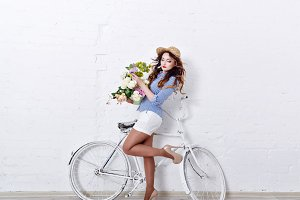 Girl with flowers and bicycle.