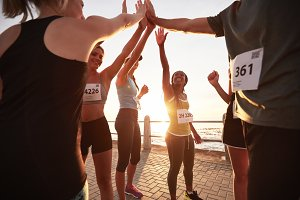Runners high fiving each other