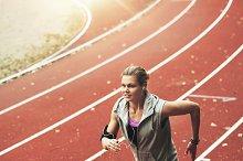 Woman running on track