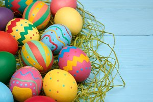 Easter eggs hand painted colorful, wood background