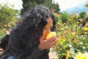 Pretty brunette smelling roses oil paint