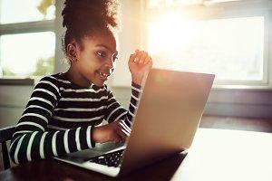 little girl working on her homework