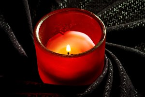 red candle over black