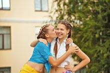 Best friends kiss on cheek