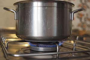 Saucepan on gas cooker