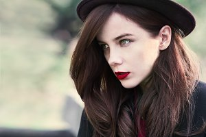girl in a hat with red lips