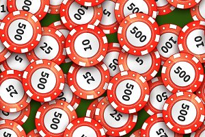 Red casino chips on green cloth