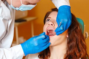 Girl on examination at the dentist