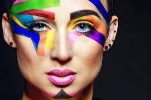 Stylist with face art portrait.