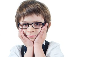 boy with glasses looking at camera
