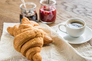 Croissants with cup of coffee