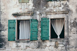 Windows with open wooden shutters