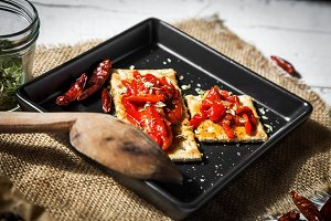 Cracker with roasted peppers