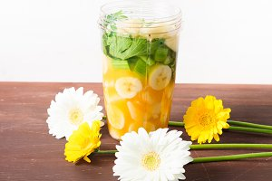 Green smoothie and flowers