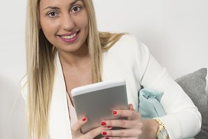 Attractive young woman uses tablet