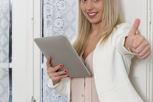 blond and attractive woman uses tablet