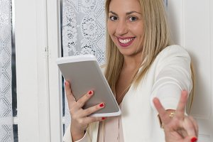 Attractive young woman with a tablet