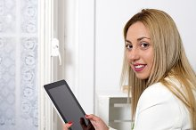 Attractive woman uses tablet