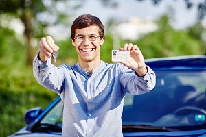 Guy with keys and driving license