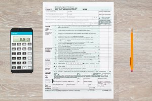 US Tax form 1040 for 2015 on desk