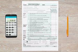 US Tax form 1040 for 2015 on desk