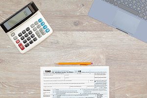 USA tax form 1040 with laptop