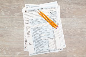 USA tax forms 1040 for 2015 on desk