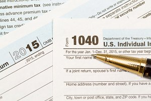 Closeup of US tax form 1040 with pen