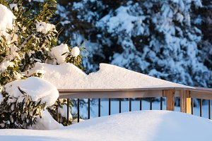 Snow piled up on deck railing