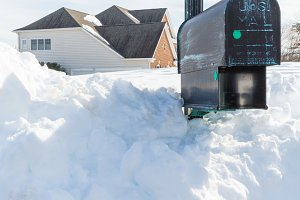Mailbox buried in snow drift